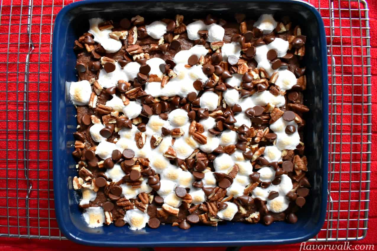 Rocky road brownies in blue baking pan on wire rack