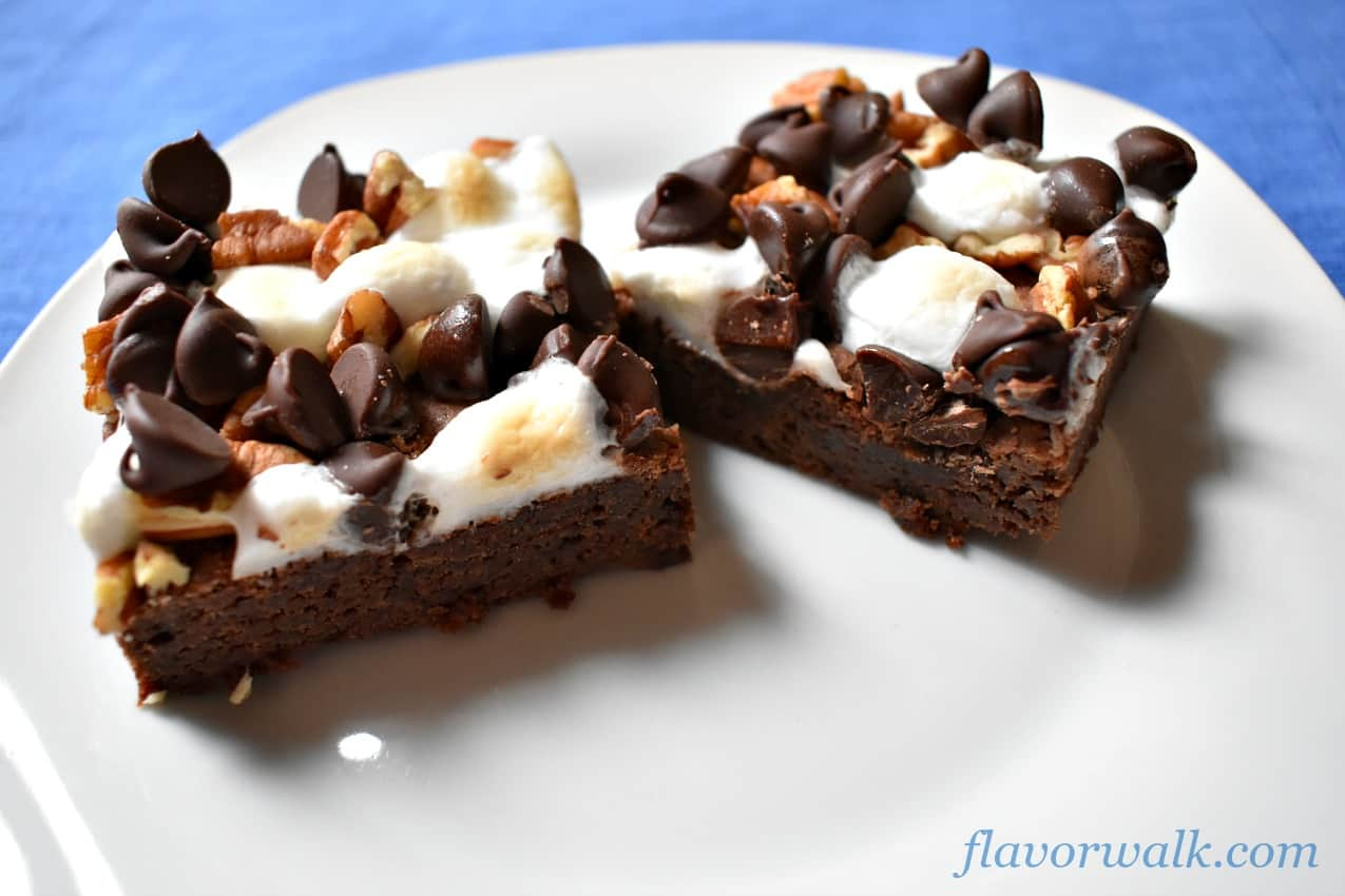 Two rocky road brownies on white plate