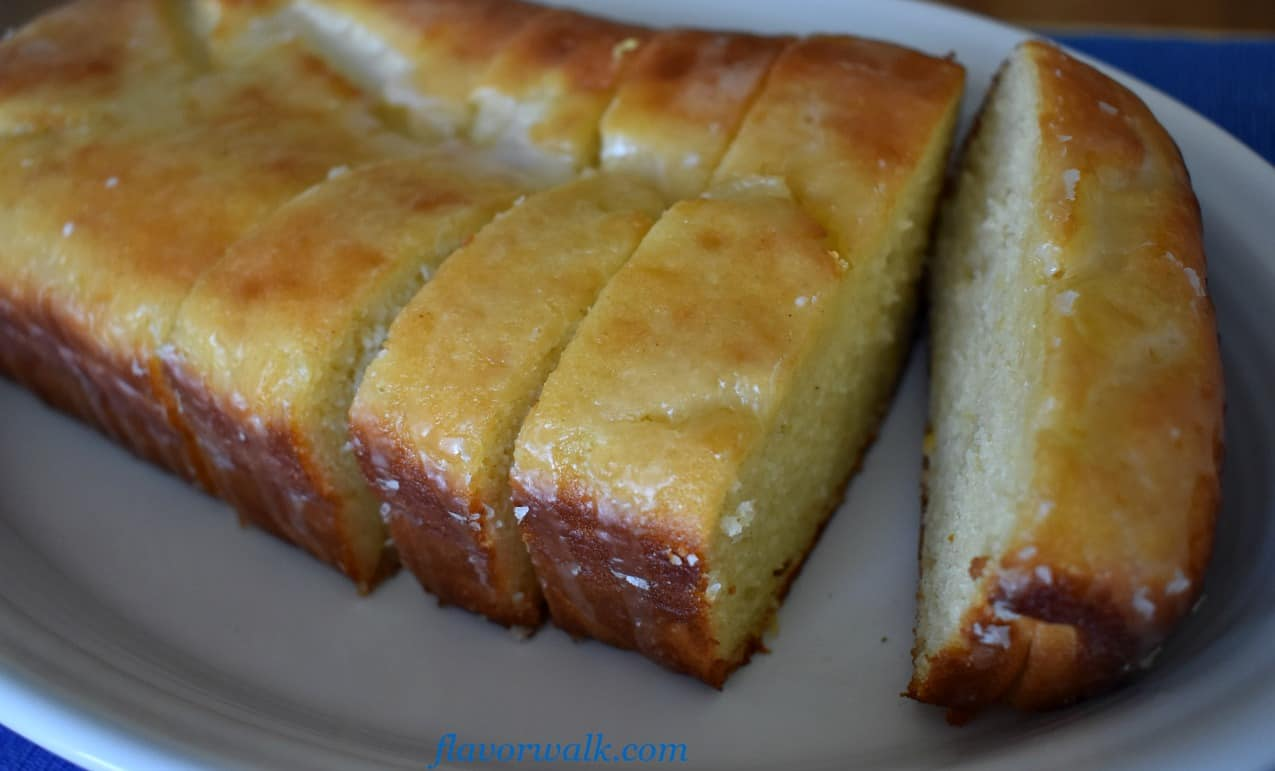 Lemon Loaf Cake with Lemon Glaze on white plate | Flavor Walk