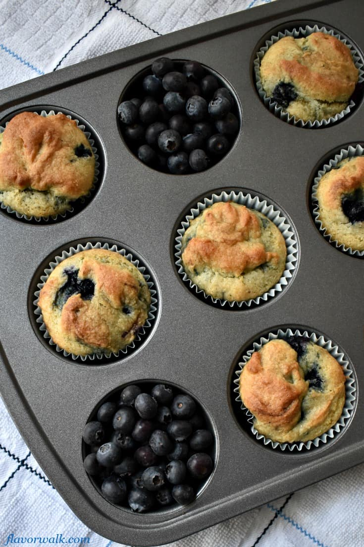 Easy Gluten Free Blueberry Muffins in muffin tin with blueberries | Flavor Walk