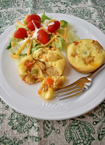 Gluten Free Mini Chicken Pot Pies with a green salad on a white plate