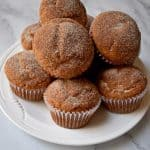 Stack of Gluten Free Cinnamon Banana Muffins on white plate | Flavor Walk