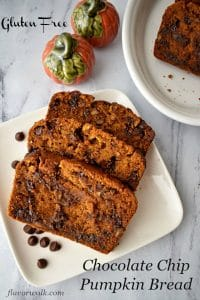 Gluten Free Chocolate Chip Pumpkin Bread is rich, extra moist, tender, loaded with chocolate chips, and chopped pecans. Traditional pumpkin bread is great this time of year, but add some chocolate and nuts and you'll be making this quick bread all year round! #glutenfree #chocolatechip #pumpkin #bread #quickbread