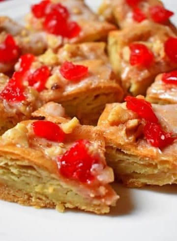 Slices of Festive Holiday Gluten-Free Almond Puff on white plate | Flavor Walk