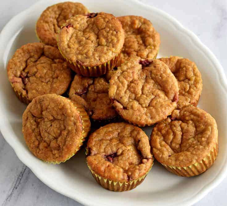 Stack of Healthy Quinoa Banana and Strawberry Muffins on a white platter