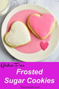 These frosted sugar cookies are soft on the inside and crisp around the edges. The almond flavored frosting makes them perfectly sweet and melt-in-your-mouth delicious. No one will guess they're gluten free! Recipe at www.flavorwalk.com #glutenfreecookies #frostedsugarcookies