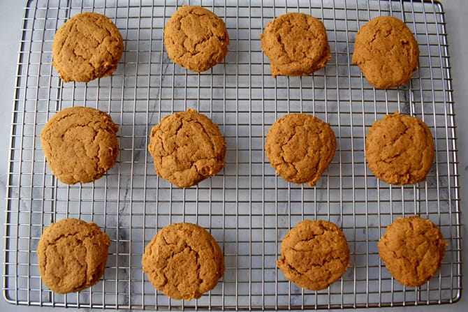 Baked pumpkin cookies on wire cooling rack