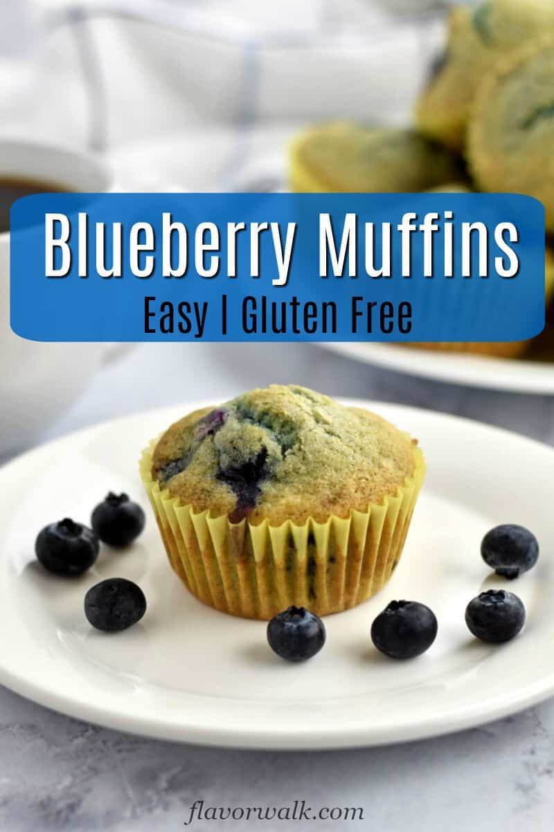 One gluten free blueberry muffin and blueberries on white plate, more muffins in upper right corner and text overlay in the middle