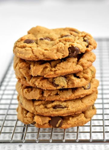 Stack of gluten free peanut butter chocolate chip cookies on wire rack