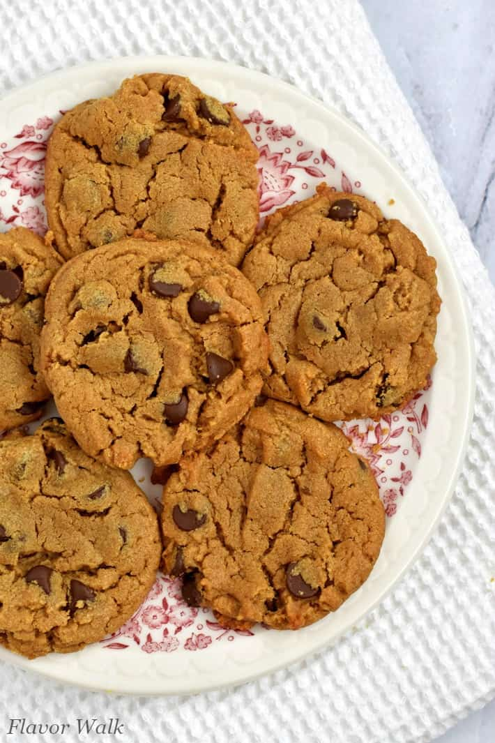 Overhead view of gluten free peanut butter chocolate chip cookies on a round plate