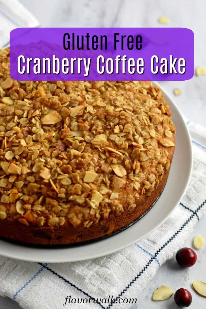 Cranberry Coffee Cake on white plate sitting on white kitchen towel with text overlay near top