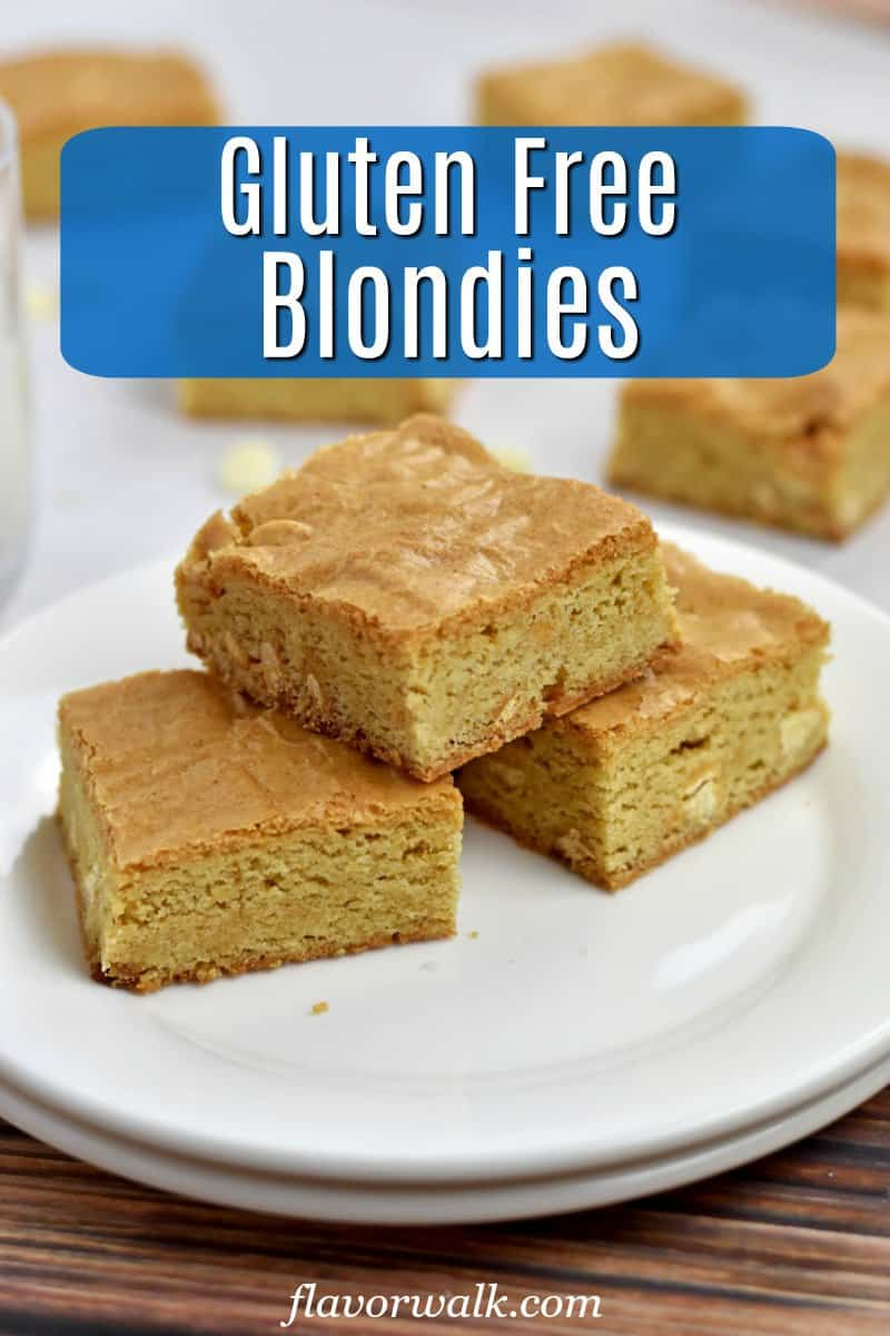 3 Gluten Free Blondies on a stack of 2 round white plates with a glass of milk and more blondies in background and blue text overlay near top