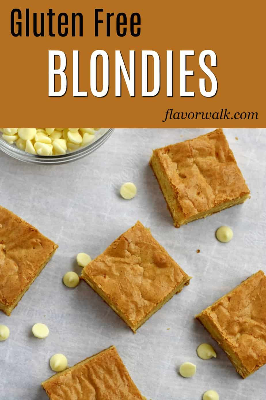 Overhead view of Gluten Free Blondies and white chocolate chips scattered on a piece of parchment paper with text overlay at the top