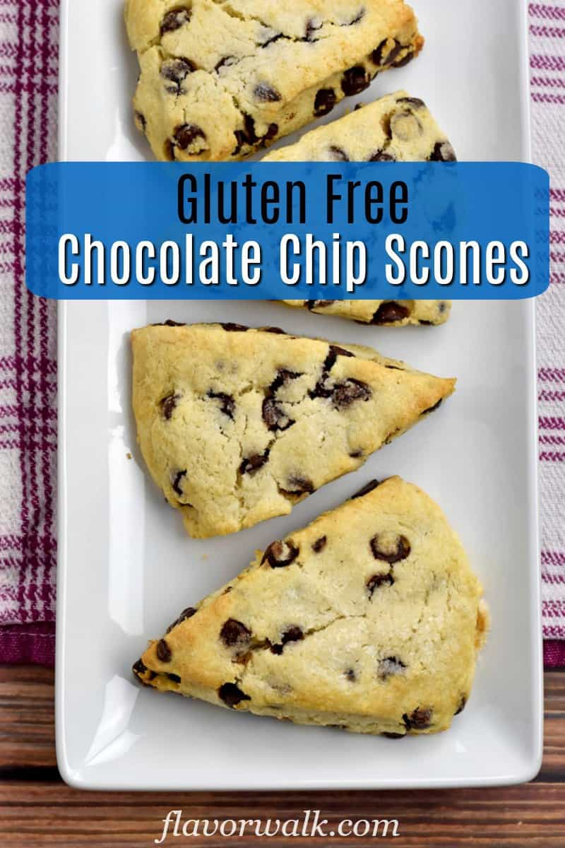 Overhead view of 4 baked Gluten Free Chocolate Chip Scones on a white rectangular plate with blue text overlay near the top