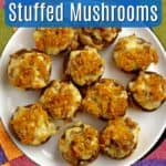 Overhead view of white plate with colorful edge filled with gluten free stuffed mushrooms with blue text overlay near top.