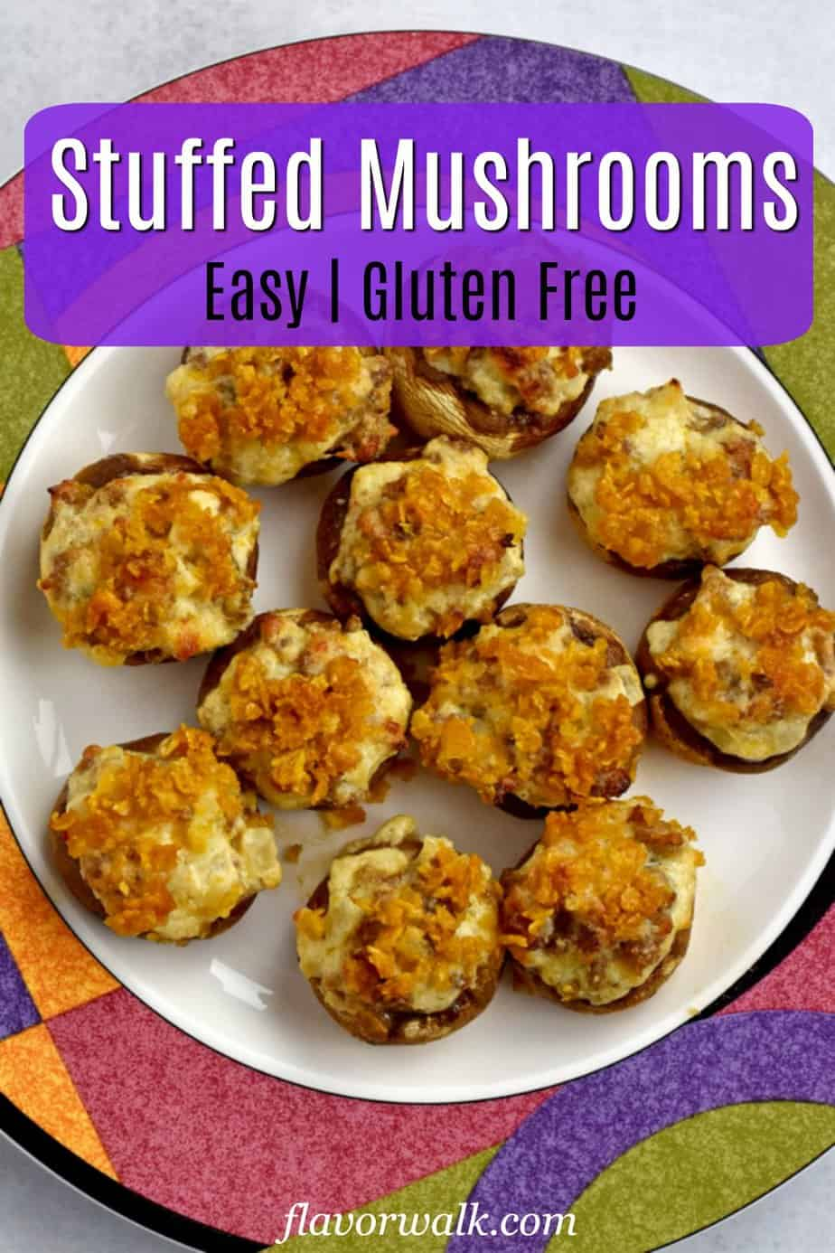 Overhead view of white plate with colorful edge filled with gluten free stuffed mushrooms with purple text overlay near top.