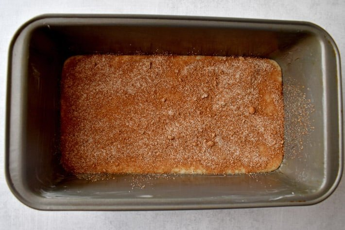 Overhead view of gluten free cinnamon bread batter and swirl ingredients in loaf pan.