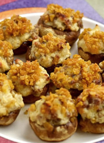 A plate of gluten free stuffed mushrooms.