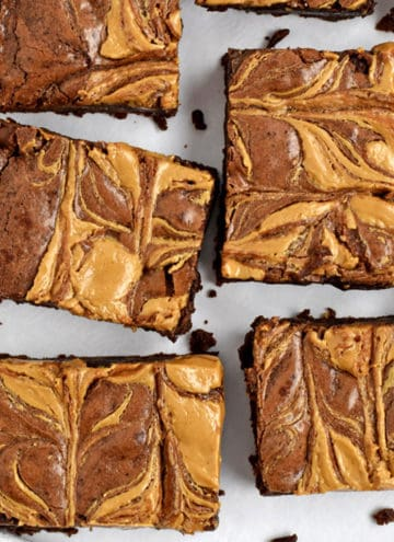 Overhead view of cut up gluten free peanut butter brownies on parchment paper.