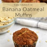 One gluten free banana oatmeal muffin, a bowl of oats, and more muffins on a wire rack in the background with a beige and black text overlay near the top of image.