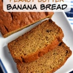 Overhead view of a loaf of gluten free peanut butter banana bread and 2 slices on a white rectangular serving platter sitting on a blue and white striped kitchen towel. A white overlay with black and brown text is near the top of the pin,
